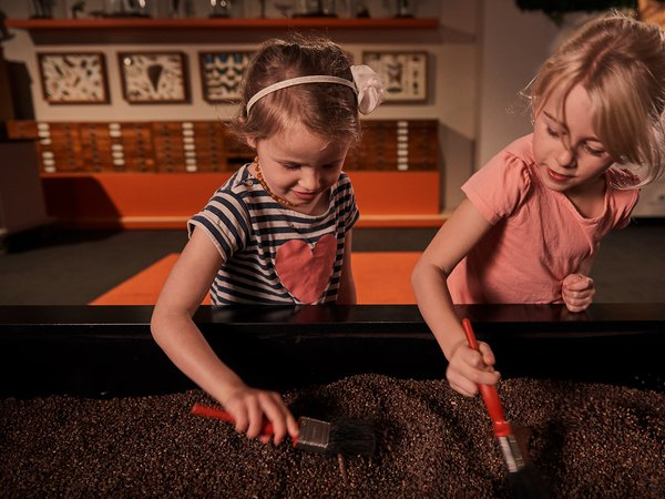 Two girls at an interactive display