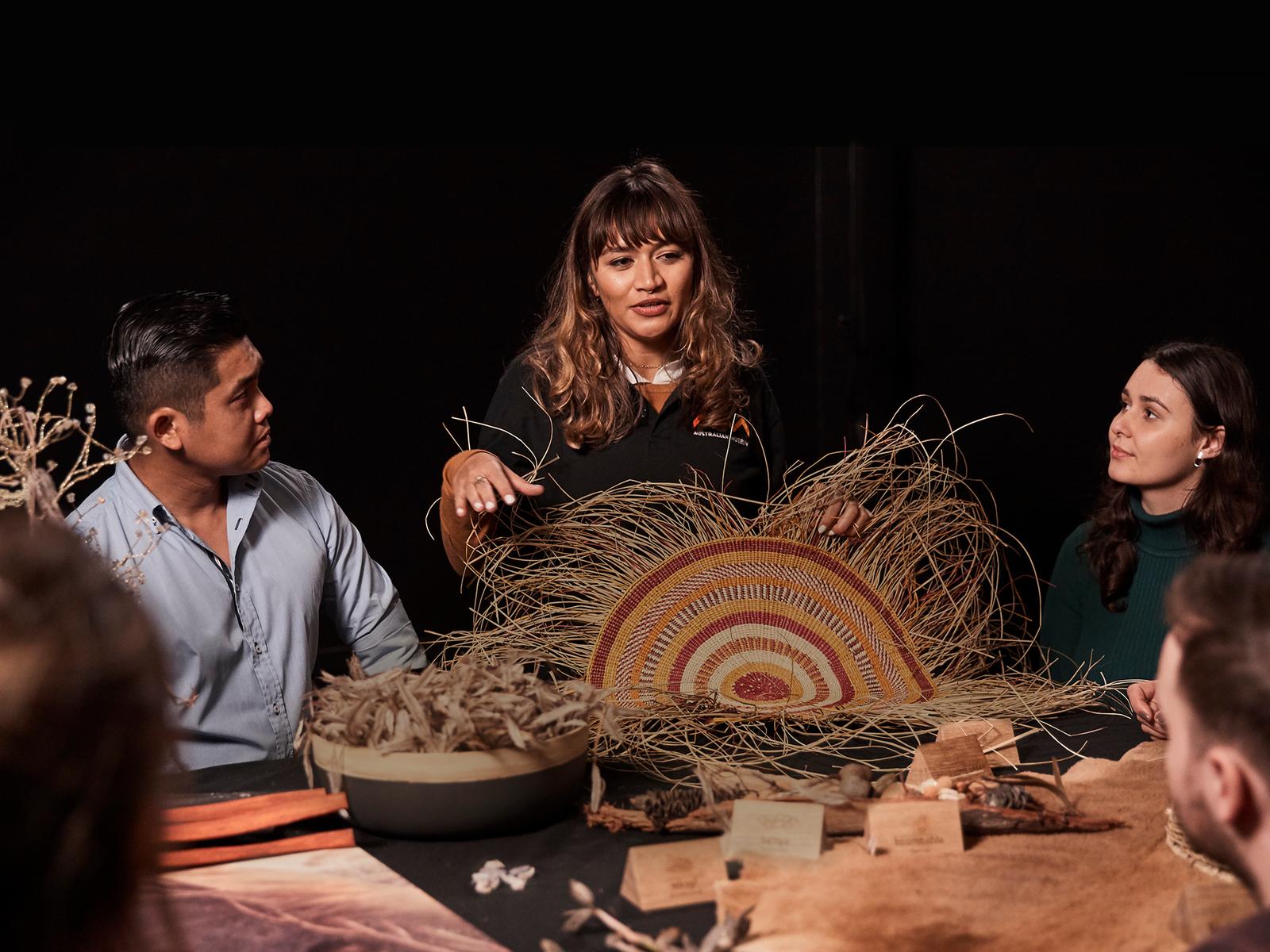 Group of people looking at weaving