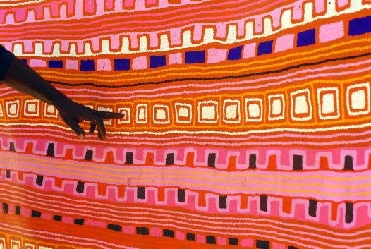 Patrick Tjungurrayi naming the waterholes on his painting, Canning Stock Route Country, 2007.