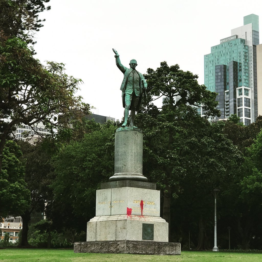 Captain Cook memorial statue with red paint graffiti