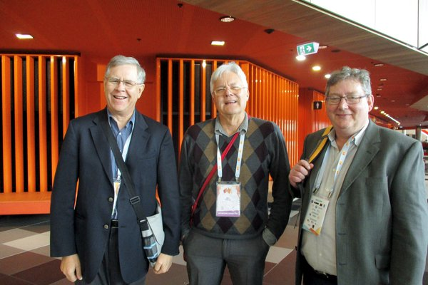 Trio of notable mineral museum, long-term acquaintances, caught between talks at IMA meeting, Convention Centre, Melbourne