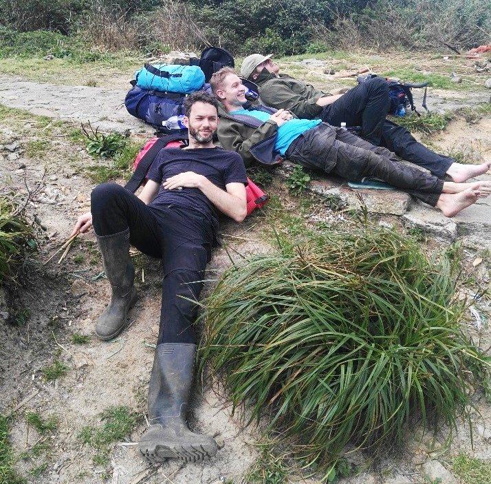 Tough work! Part of the survey team take a break from climbing Mount Fanispan, Hoang Lien Ranges, northern Vietnam.