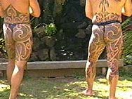Two warriors standing showing their complete puhoro