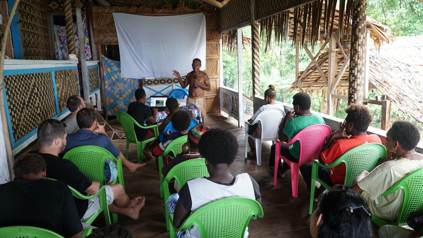 Chief Esau, a local community leader, presents during the Gala workshop.