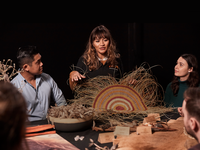 Group of people looking at weaving