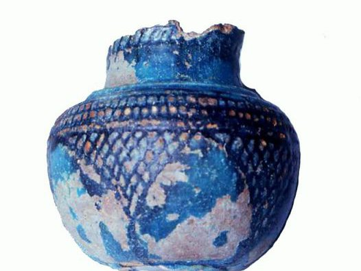 Blue ceramic vase with relief design and richly coloured glaze, Oxyrhynchus, Upper Egypt.