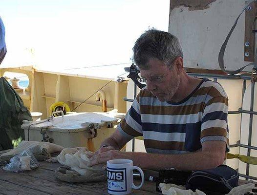 Mark mending a net
