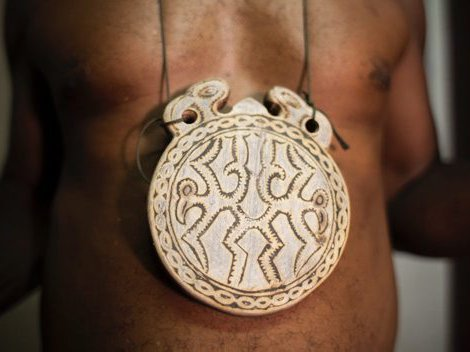 Pendants carved with the teeth of giant rats, Solomon Islands
